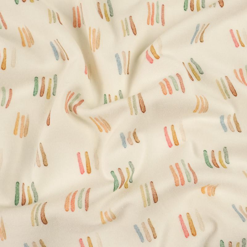 Jersey de coton crème bio petits traits pastels