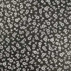 Coton imprimé fleurs blanches sur fond noir